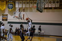 #23 Tasleem Lawal going in hard to the hoop and drawing the contact against the Frederick Christian Defenders!